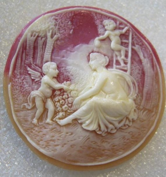 Vintage celluloid or early plastic cameo pin brooch