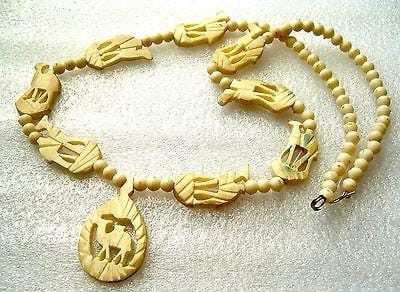 Vintage faux ivory or faux bone hand carved ethnic necklace with camels