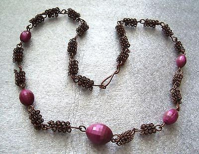 Vintage wrapped copper wire with faceted purple plastic beads