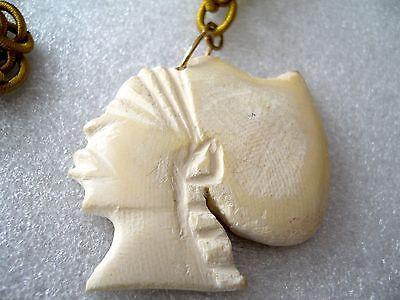 Vintage faux bone Egyptian ? head on fabric chain necklace
