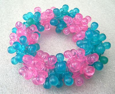 Vintage 1980's plastic lucite sparkling fuchsia & turquoise expandable bracelet