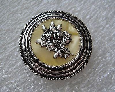 Vintage mother of pearl or celluloid and silver tone flower scarf clip
