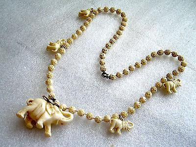 Vintage molded early plastic or celluloid elephants and roses necklace