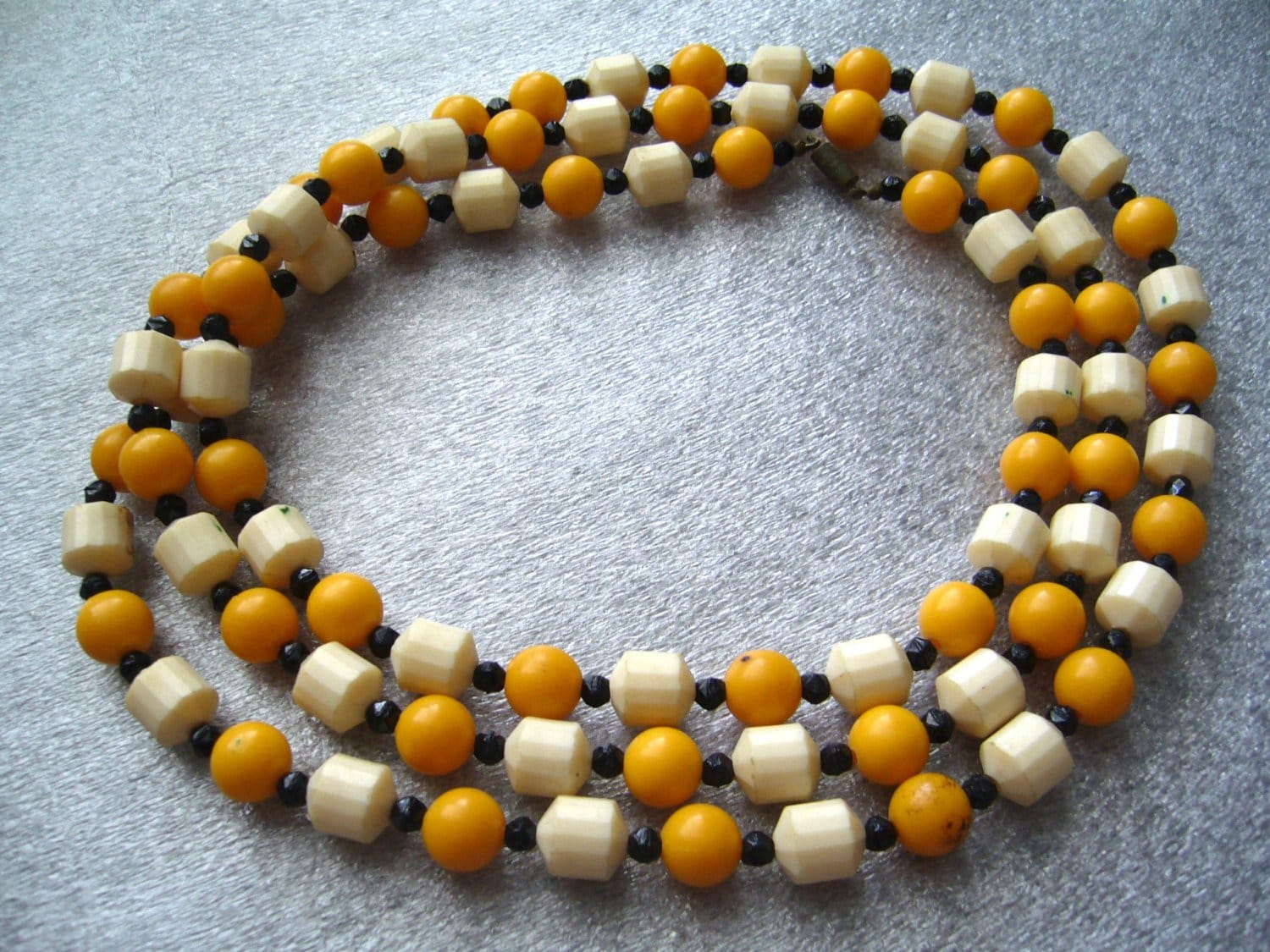 Vintage faceted yellow and off-white beads early plastic long necklace