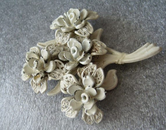 Vintage carved celluloid filigree flower pin brooch