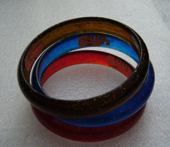Vintage plastic red blue and brown bangles with Israeli label