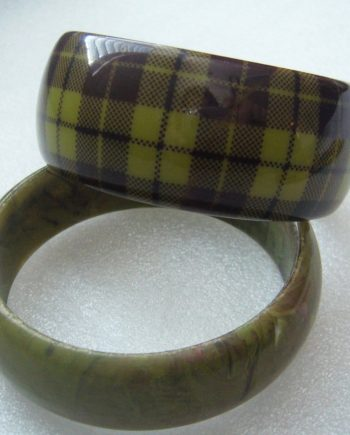 Pair of vintage greenish early plastic bangles / bracelets