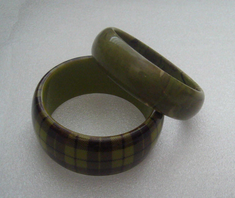 Pair of vintage greenish early plastic bangles / bracelets