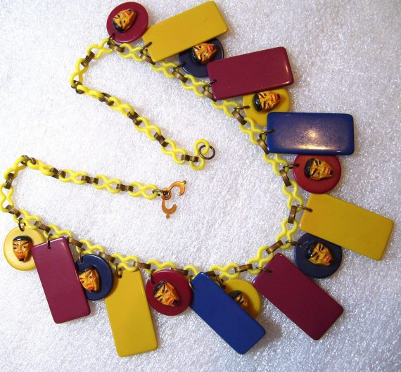 Vintage celluloid , early plastic & galalith art deco necklace with masks