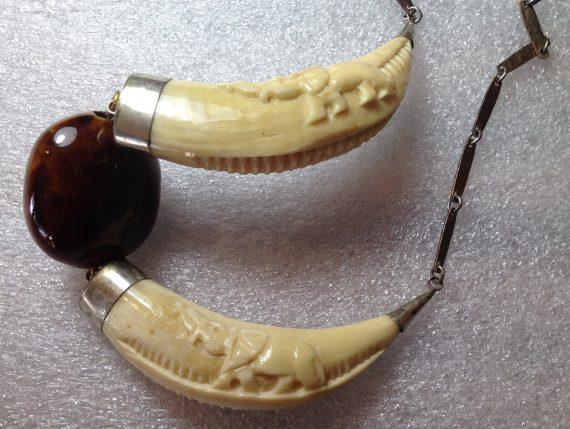 Vintage hand carved elephants necklace - ivory or bone or shell?