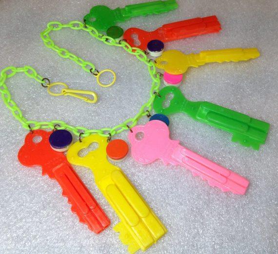 Vintage celluloid huge keys whistles necklace
