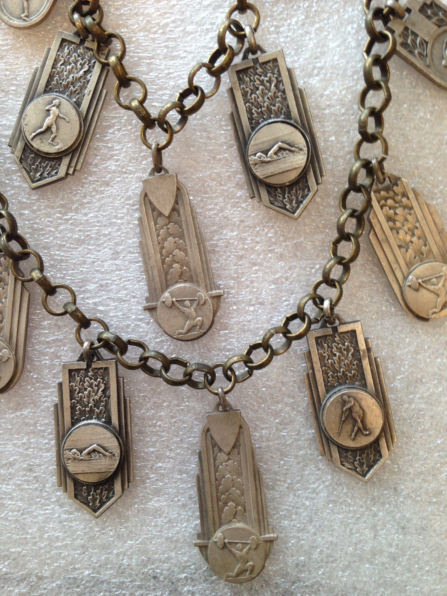 Vintage brass and silver-tone metal sports' medals necklace