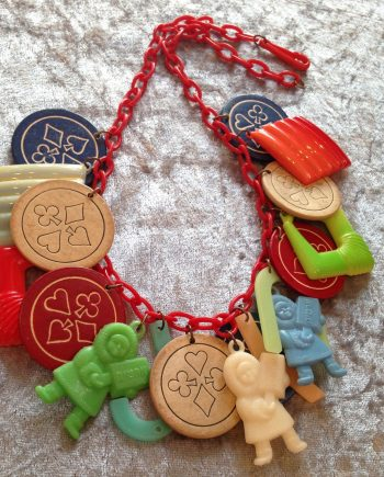 "Vintage style early plastic 1960's  ""Eskimo"" & charms necklace"