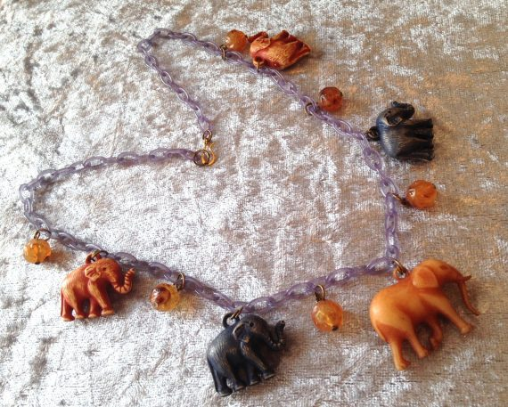 Vintage early plastic elephants necklace