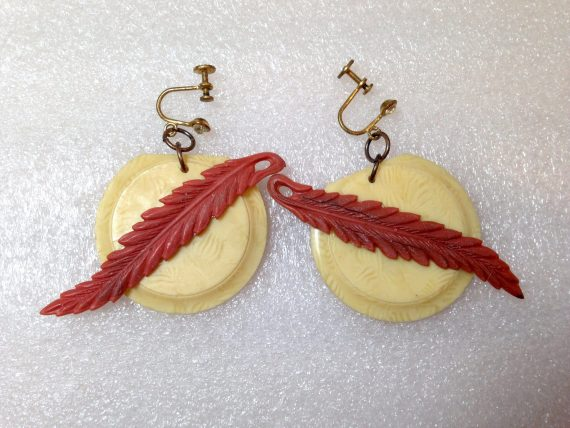 Vintage celluloid screw earrings with leaf