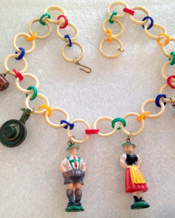 Vintage Tyrol's figurines, hat, shoes celluloid necklace