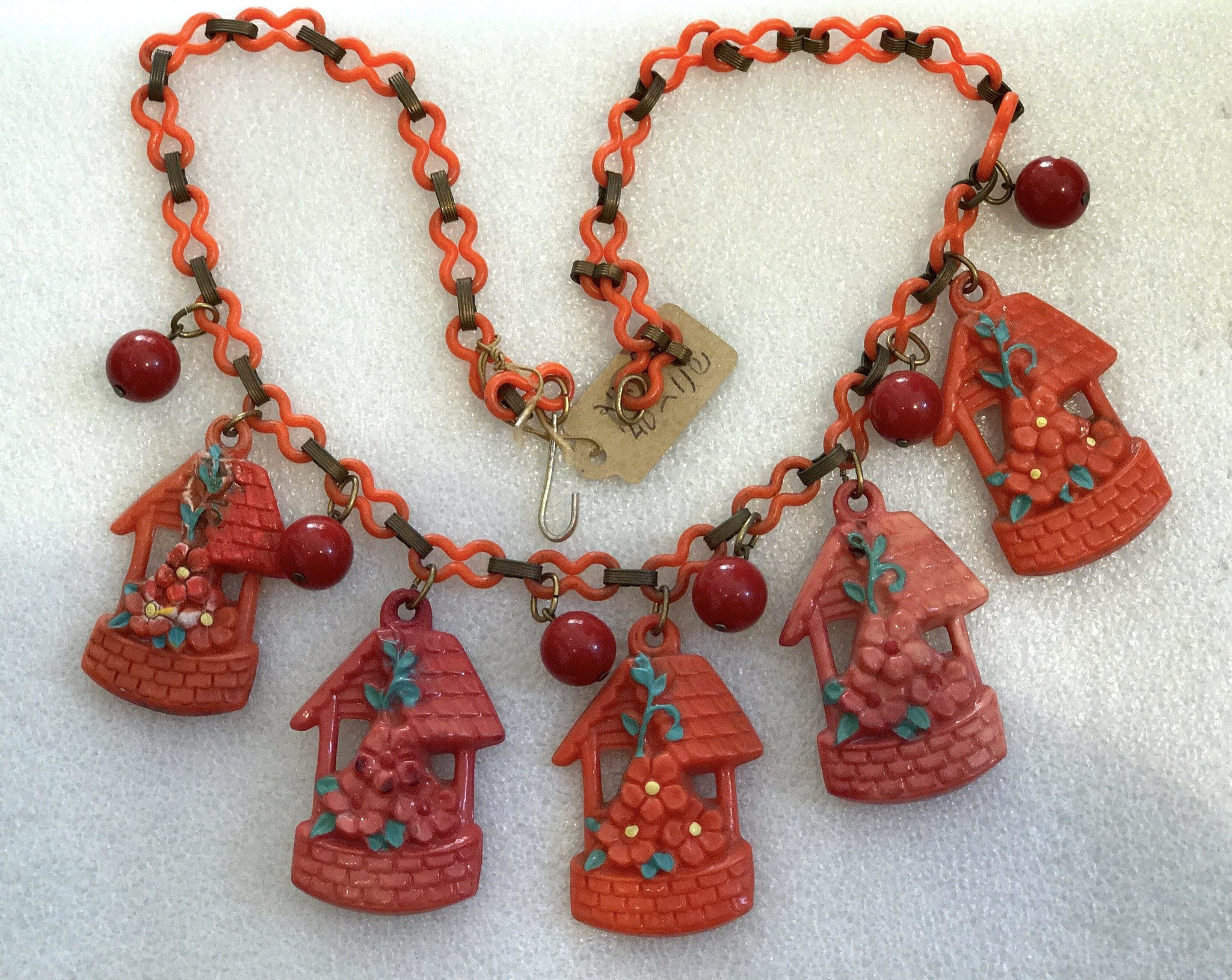 Vintage hand painted celluloid early plastic little houses red necklace