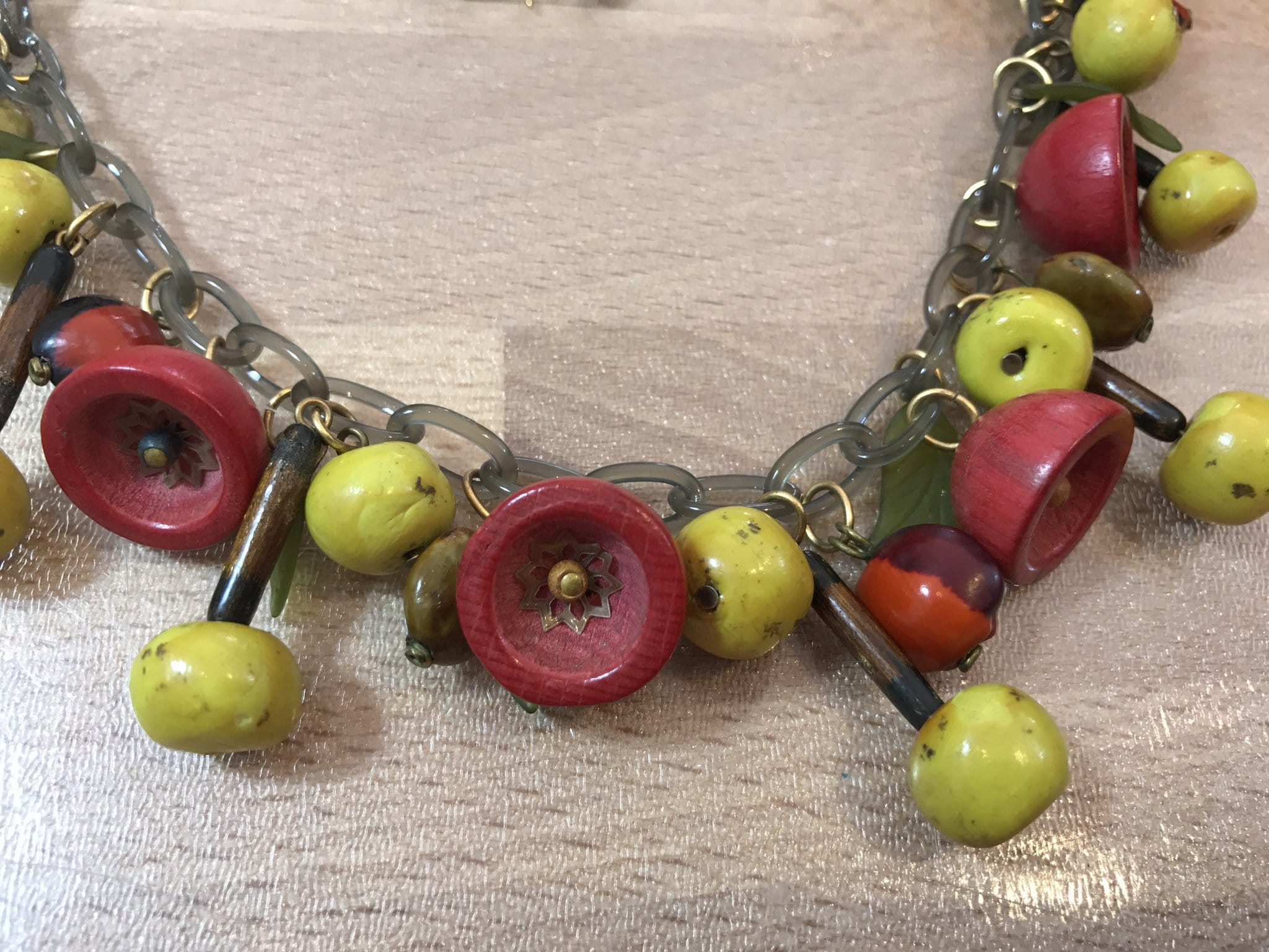 Vintage celluloid, early plastic, wood & seeds unsigned Miriam Haskell necklace