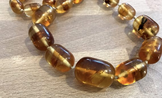 Vintage faux amber early plastic knotted necklace